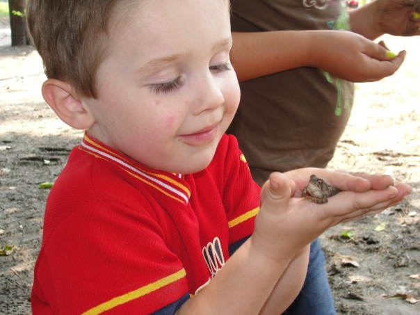 Colton with a frog