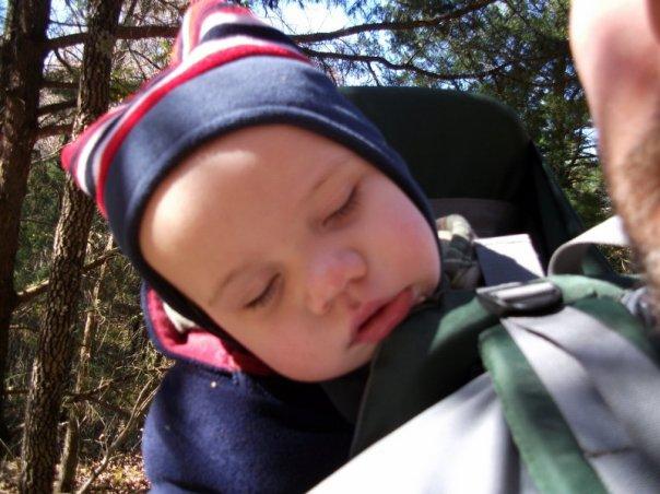 Otis almost asleep in the backpack