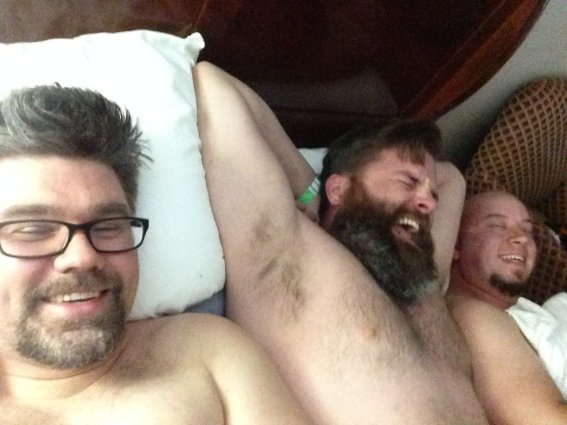 three men in a bed at Land Run 100